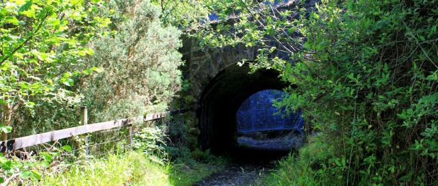 08 under the railway line, Ruth hiking round the coast of Scotland