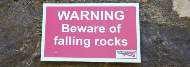10 beware of falling rocks sign, Duncraig, Ruth hiking round the coast of Scotland