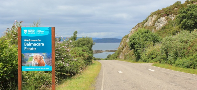 11 sign for Balmacara estate, road to Plockton, Ruth walking the coast of the Scottish Highlands