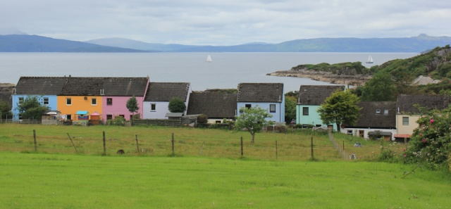 17 Erbusaig and coloured houses, Ruth walking the coast of the Scottish Highlands