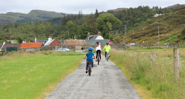 25 children cycling from Duirinish Station, Ruth walking the coast of the Scottish Highlands