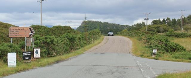 32 turnoff to Craig Highland Farm, Ruth walking the coast of the Scottish Highlands