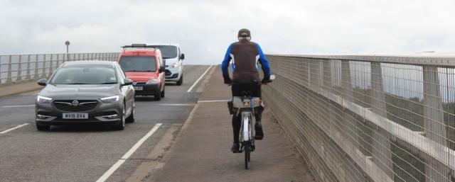 42 cyclist again, Ruth crossing Skye Bridge, coastal walk