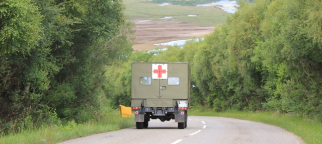 60 army ambulance, Ruth walking the shore of Loch Carron