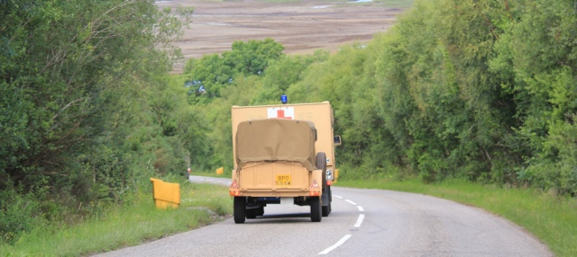 61 more army vehicles, Ruth walking the shore of Loch Carron