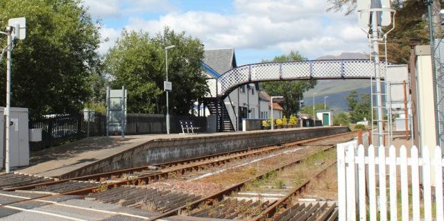 66 Strathcarron station, Ruth walking the shore of Loch Carron