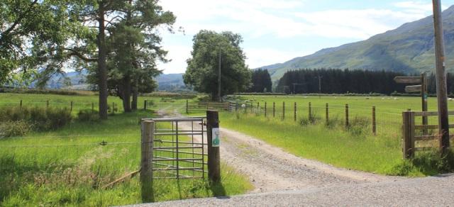 70 track across fields, Ruth walking the shore of Loch Carron