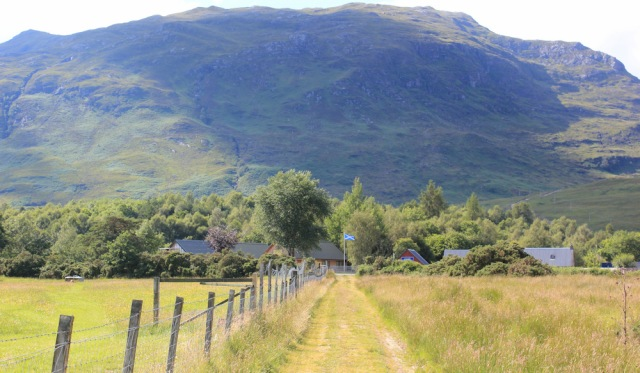 74 approaching the road, Ruth hiking over fields to Lochcarron, Scotland