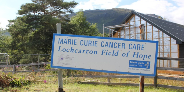 76 Marie Curie field of hope, Ruth walking the shore of Loch Carron