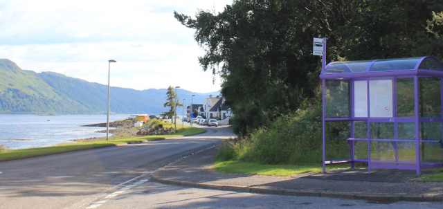 86 bus stop in Lochcarron, Ruth hiking around the coast of Scotland NC500