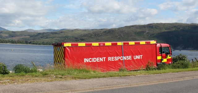 87 incident response unit, Ruth walking the shore of Loch Carron