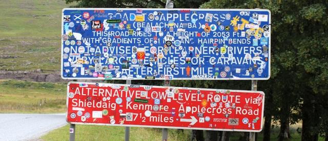 07 stickered signs at Applecross turnoff, Ruth's coastal walk Scottish Highlands