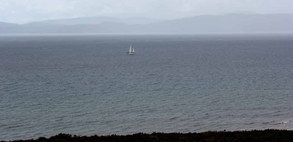 03 sailing ship and rain clouds, Ruth walking up the coast of Applecross, Scotland