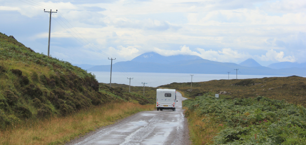 12 caravans on the road to Applecross, Ruth hiking up the coast of Applecross, Scotland