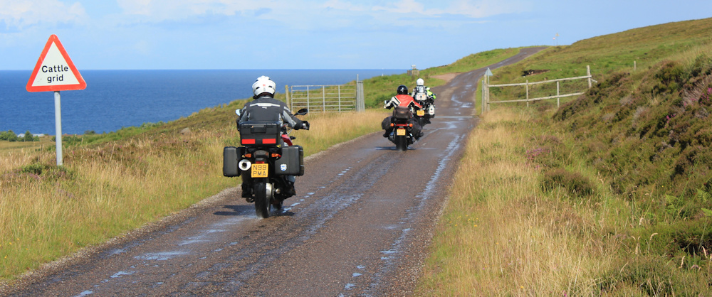 15 motorbikes and cattle grids, Ruth walking up the coast of Applecross, Scotland