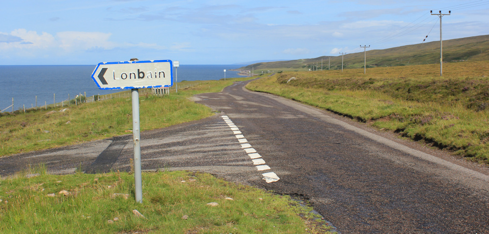 18 Londbain sign, Ruth walking up the coast of Applecross, Scotland