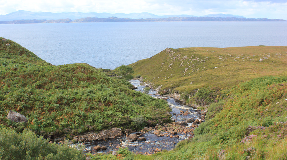 26 Allt an t-Strathain, Ruth walking up the coast of Applecross, Scotland