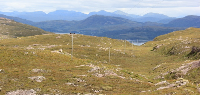 28 following telegraph poles down to the sea, Ruth hiking around Applecross, Scotland