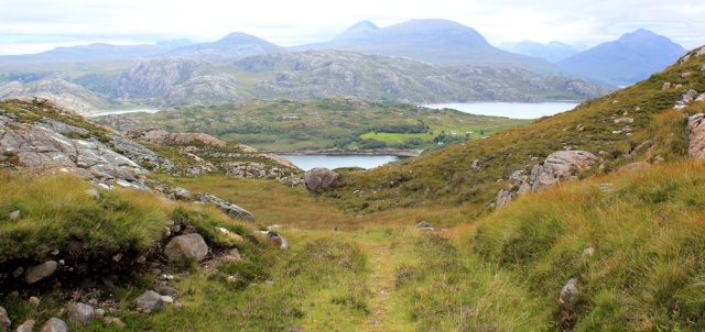 10 over the shoulder of A' Bhainlir, Ruth walking the south bank of Loch Torridon, Scotland