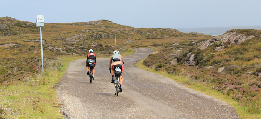 13 touring cyclists, Ruth hiking around the north of Applecross, Scotland