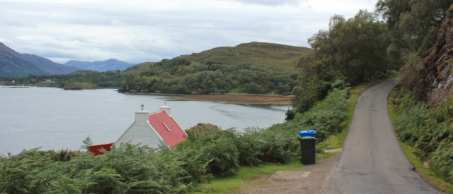 22 red-roofed house, Ruth walking the south bank of Loch Torridon, Scotland