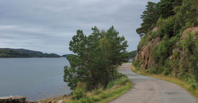 44 winding road with cliffs, Ruth hiking the coast, Wester Ross, Scotland