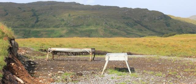05 cattle feeding troughs beside road, Ruth walking across the Morvern Peninsula, Scotland