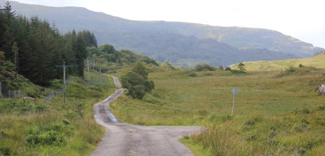 10 winding road along edge of forest, Ruth walking across the Morvern Peninsula, Scotland