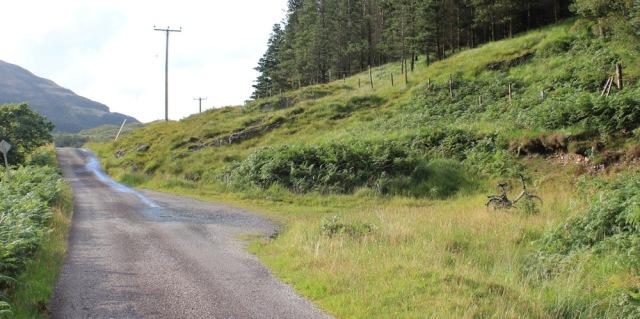 18 Scooty bike waiting in layby, Ruth hiking across the Morvern Peninsula, Scotland