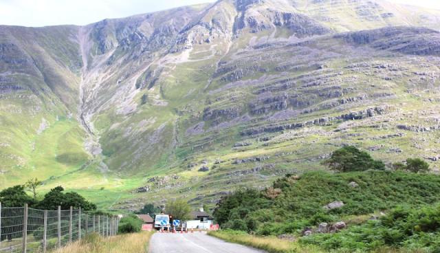 007 road works near Annat, Ruth walking the coast of north-west Scotland