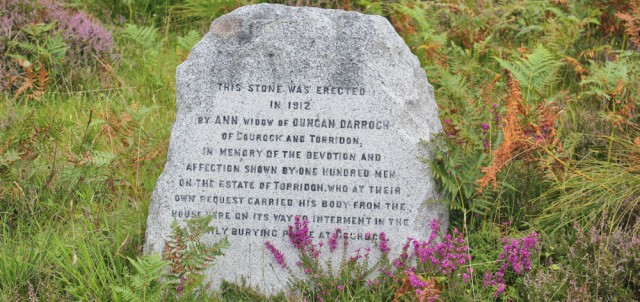 019a commemoration stone by side of road, Ruth walking the coast of north-west Scotland