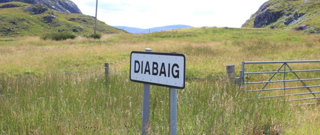 37 Diabaig road sign, Ruth walking the coast of NW Scotland