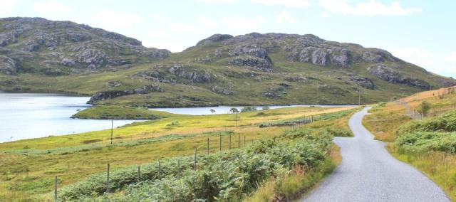42 Loch a'Mhullaich and Loch Diabaigas Airde, Ruth walking the coast of NW Scotland