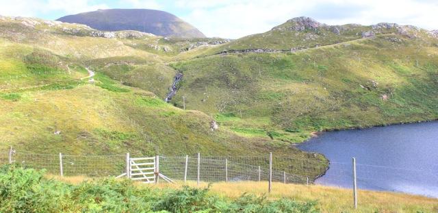 43 Tom na Gruagaich, Beinn Alligin, Ruth walking the coast of NW Scotland