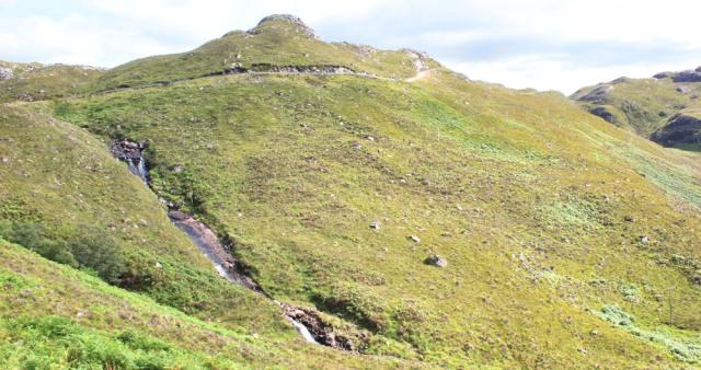 44 steep road and waterfall, Bealach na Gaoithe, Ruth walking the coast of NW Scotland