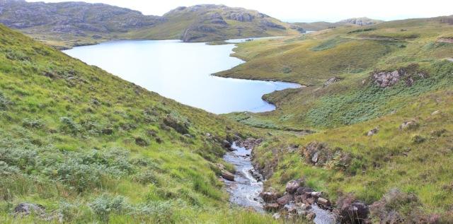 45 photo above the waterfall, Bealach na Gaoithe, Ruth walking the coast of NW Scotland