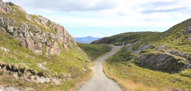 48 down to Bealach na Gaoithe, Ruth walking the coast of NW Scotland