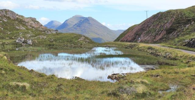 49 lochan with no name, Bealach na Gaoithe, Ruth walking the coast of NW Scotland
