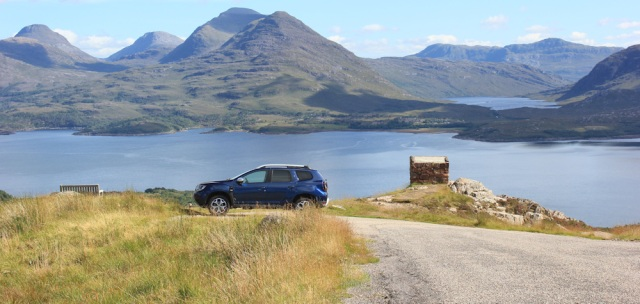51 parking spot, Bealach na Gaoithe, Ruth walking the coast of NW Scotland