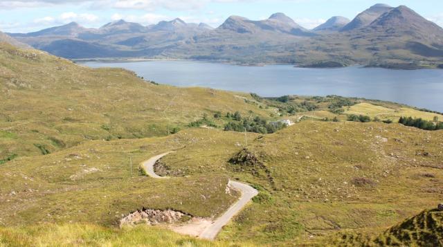 53 twisting road down to Alligin, Bealach na Gaoithe, Ruth walking the coast of NW Scotland